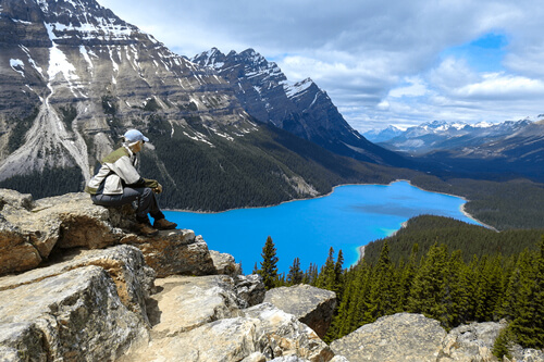 A hiker enjoying view at the Peyto Lake in the Banff National Park in Alberta