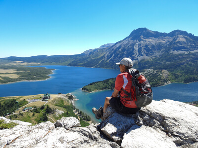 Taking a nice break on top of Bear Hump trail overlooking the vast valley of the Waterton Lakes National Park. What a view!
