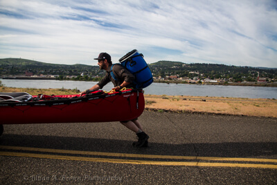 Martin Trahan pushing his canoe with his LOWA Renegade GTX Mid during a very long portage