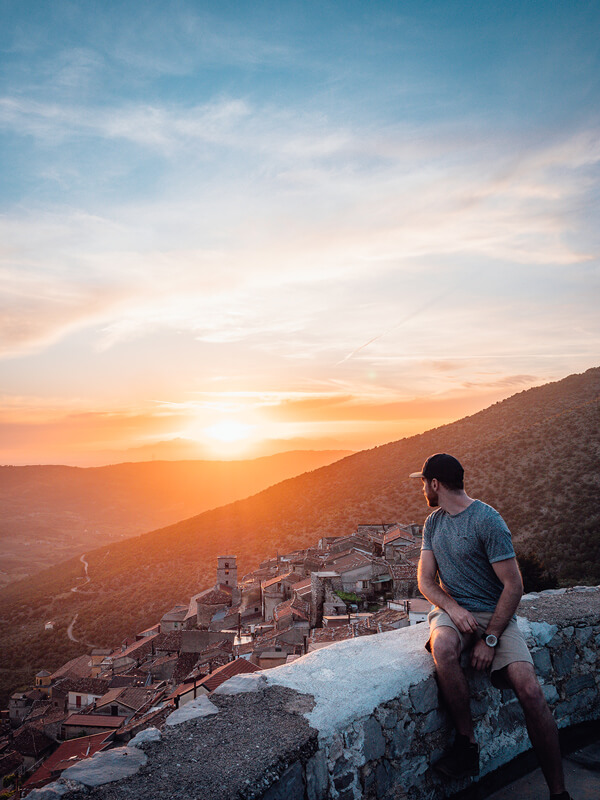 Ben Chamberland looking at the sunset over a rural village in Italy